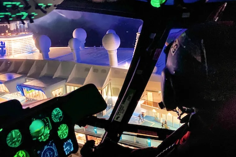 The crew of U.S. Coast Guard MH-65 Dolphin Helicopter from Air Station Atlantic City arrives to airlift an ailing 70-year-old man from the Anthem of the Seas cruise ship off the New Jersey coast on Saturday, Dec, 28, 2019.