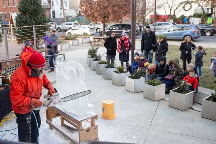 People watch an ice sculpture carving demonstration at the Lutheran Settlement House Saturday, December 8, 2018. Many in the Fishtown community have rallied to support the house. MARGO REED / Philadelphia Inquirer