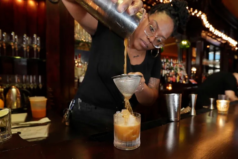 General manager Janelle Findlator makes the Sits Easy (chamomile tea, coconut nectar, orange and lemon) at the Royal Tavern, which added a zero-proof section to its drink list recently.