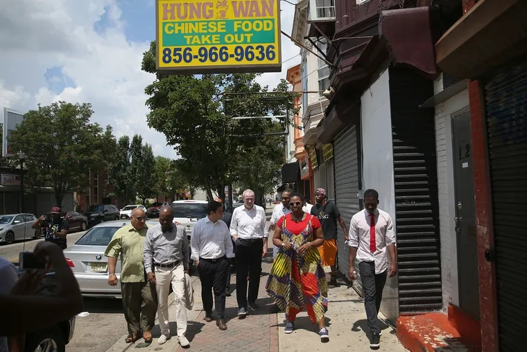 Gov. Phil Murphy (center) walks down Haddon Avenue during a tour of Camden this summer. Camden and other New Jersey communities are benefiting from increased participation in after-school snack and supper programs that feed low-income children.