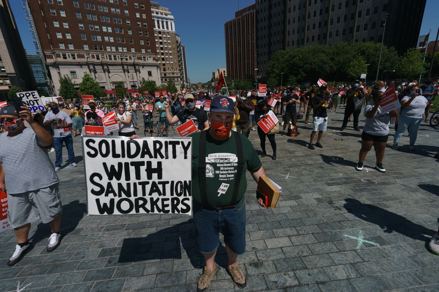 Attendees at a rally and protest to support sanitation workers who are requesting hazard pay and PPE, engage in a social distancing protest at LOVE Park, in Philadelphia, June 09, 2020.