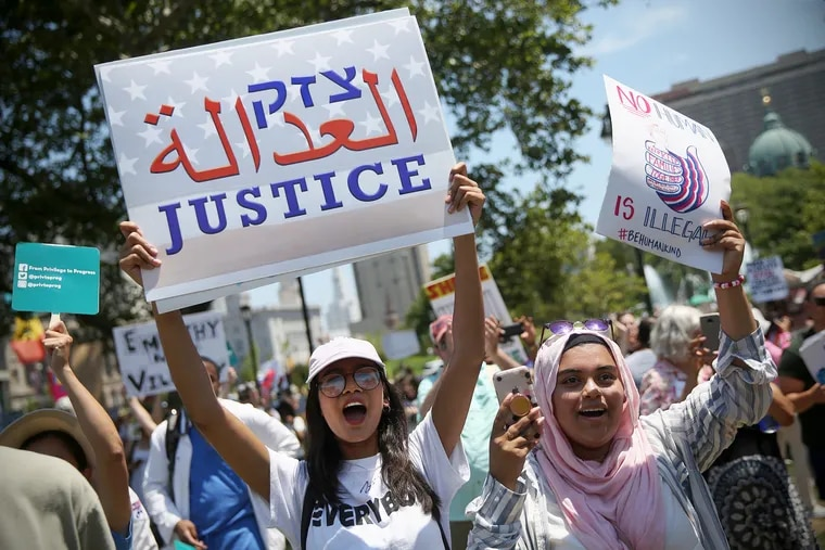 Audrika Khondaker, left, and her friend Afra Anan, both of Breinigsville, Pa., cheer during a protest against the Trump administration's separation and detention of immigrant families at Logan Square in Philadelphia in June 2018. Ahead of the November election, Philadelphia activist groups are planning to mobilize protesters in the event of electoral discord.
