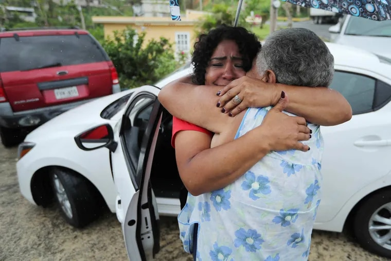 Quetcy Lozada embraces her aunt Elisa DelValle after two weeks as a volunteer with the Salvation Army in Puerto Rico Tuesday October 31, 2017.