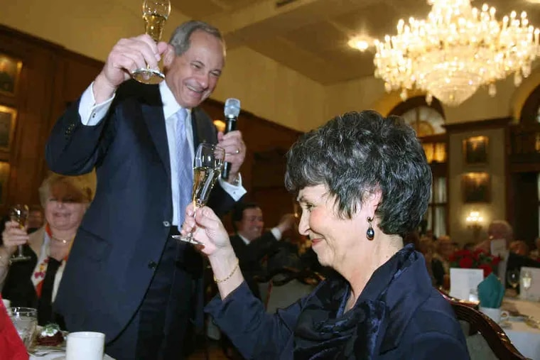 Joan Carter (right) accepts a toast from husband John Aglialoro. She is the first female president in the Union League's 148-year history.