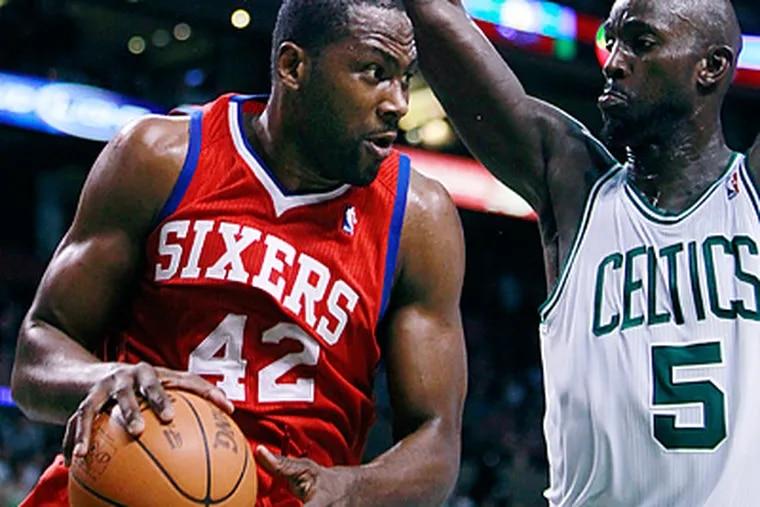 Elton Brand looks to drive to the basket against Celtics' Kevin Garnett in the third quarter. (AP Photo/Michael Dwyer)
