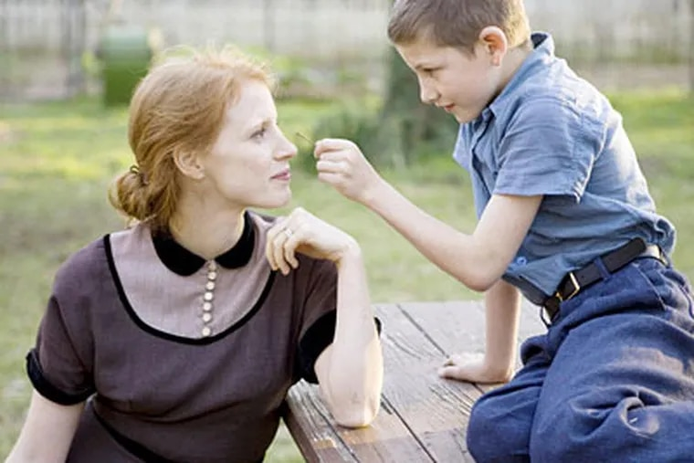 """Jessica Chastain with Brayden Whisenhunt in a scene from """"The Tree of Life,"""" winner of the Prix d'Or at the Cannes Film Festival."""