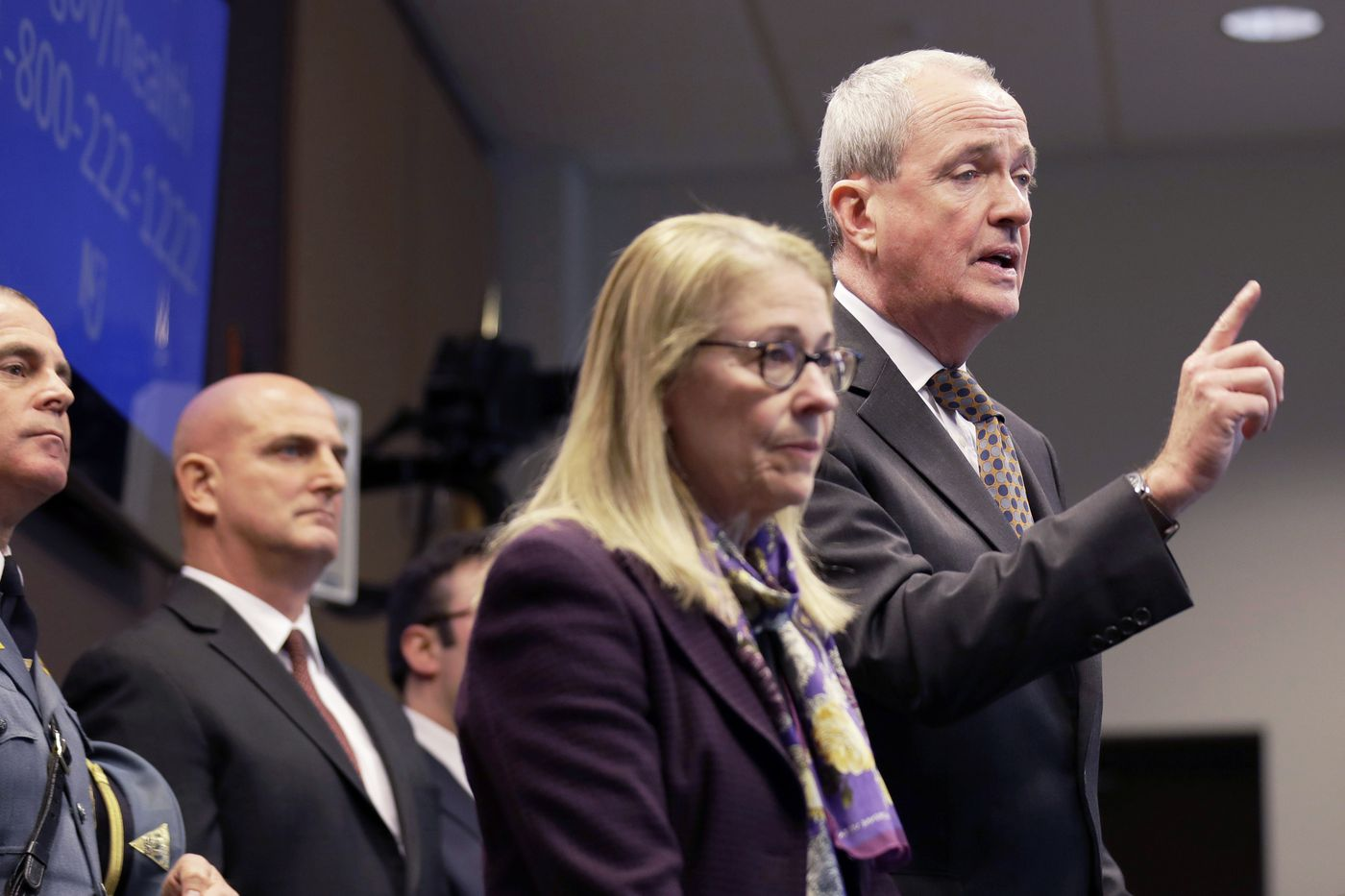 FILE- In this March 2, 2020 file photo, New Jersey Gov. Phil Murphy, right, is joined by Health Commissioner Judith Persichilli, center, during a news conference in Ewing, N.J., Monday, March 2, 2020. On Wednesday, March 4, 2020, Murphy, Persichilli and Acting Governor Sheila Oliver announced the first presumptive positive case of novel coronavirus, or COVID-19, in New Jersey. The individual, a male in his 30s, is hospitalized in Bergen County and has been hospitalized since March 3. (AP Photo/Seth Wenig, File)