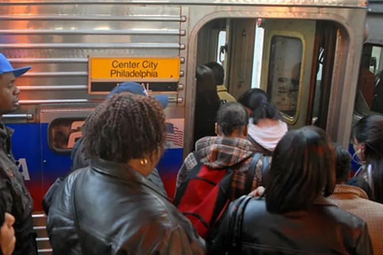 Commuters board a Philadelphia-bound Regional Rail Line train at SEPTA's Fern Rock Transportation Center this morning. ( Tom Gralish / Staff Photographer )