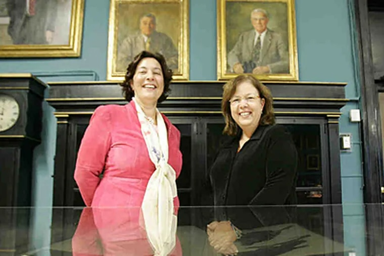 Sara Hertz and Cathy Wilt (right) at the Academy of Natural Sciences. President George W. Gephart Jr. added Hertz to work on strategic initiatives and Wilt to digitize the library. (David Swanson/Staff)