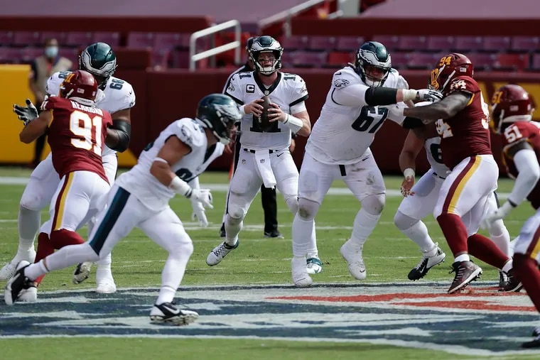 Eagles quarterback Carson Wentz is in his fifth season, and yet there were multiple times in Sunday's loss when he unnecessarily tried to extend a play, and it hurt his team.  Eagles quarterback Carson Wentz looks for receiver against the Washington Football Team on Sunday, September 13, 2020.