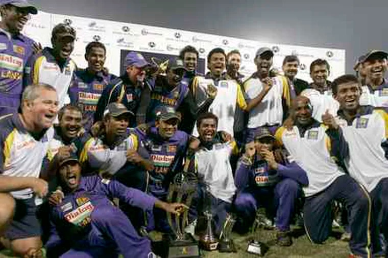 The Sri Lankan cricket team poses with the trophy it won in a January match against Pakistan. Besides the deaths of six police and one driver, seven players were hurt in Lahore yesterday.