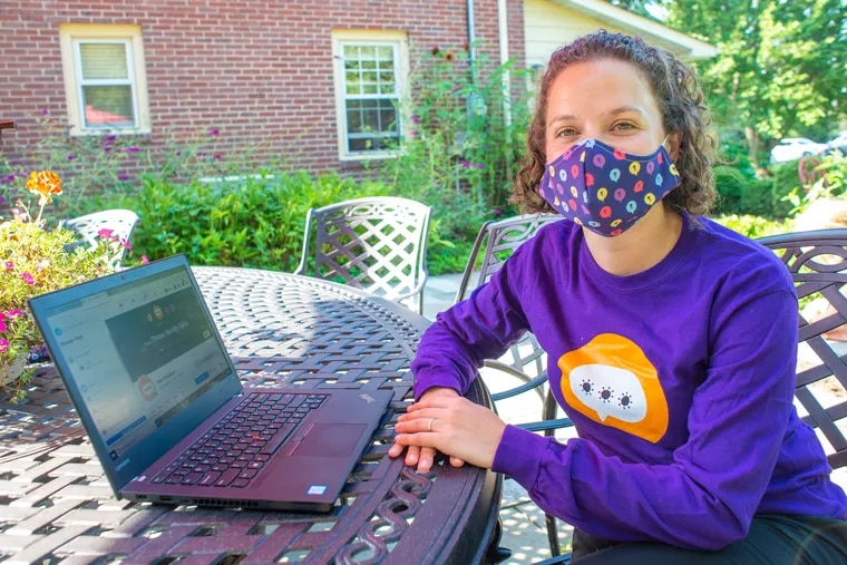 Ashley Z. Ritter, CEO of Dear Pandemic reads some of the posts on the group's website and facebook pages while wearing a Dear Pandemic tee shirt  Thursday, August 05, 2021 at her home in Yardley, Pennsylvania. A group of Philadelphia-based scientists created Dear Pandemic last March to help friends, family and the public make sense of COVID-19.