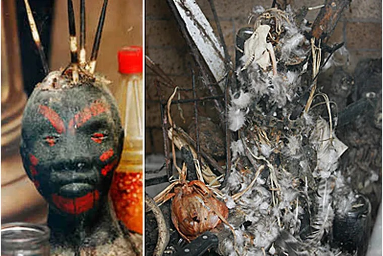 Investigators found a ritualistic statue (left) and feathers and knives streaked in blood inside a Feltonville home. (Alejandro A. Alvarez / Staff)