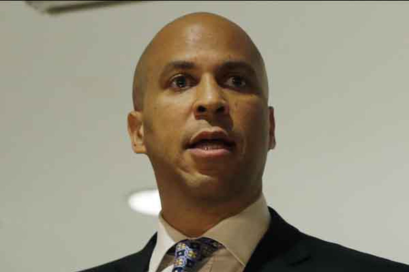 Democrat Holt's video contrasts him with Booker