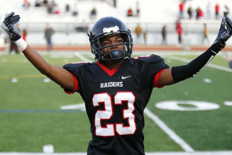 Archbishop Ryan's Jasir Burnett leads the team's fans in celebration after a victory over Archbishop Carroll in a Catholic League Class 5A football quarterfinal on Saturday.