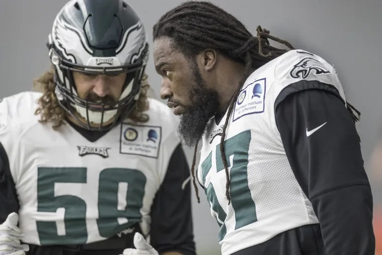 Dannell Ellerbe, #57, right, seems to have supplanted Joe Walker, #59, left, as the replacement for injured middle linebacker Jordan Hicks. MICHAEL BRYANT / Staff Photographer
