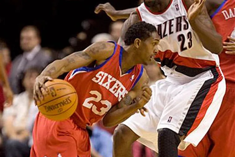 The 76ers' defense is ranked 20th in the league while their offense is ranked 22nd. (Don Ryan/AP)