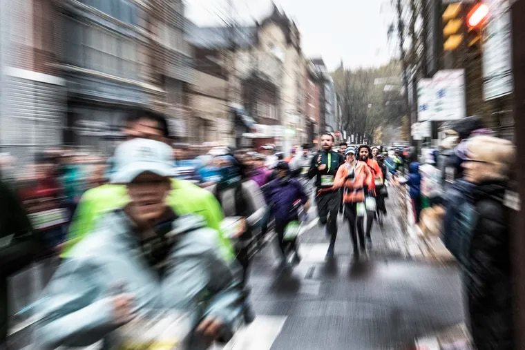 Participants run through Old City during the 2019 Philadelphia Marathon.