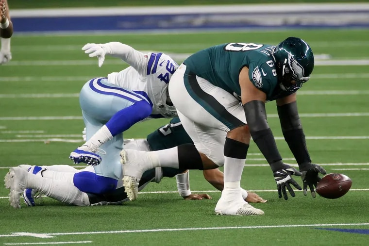 Eagles tackle Jordan Mailata (68) recovered a fumble after Dallas Cowboys defensive end Randy Gregory (94) sacked Eagles quarterback Jalen Hurts (2) in the third quarter Sunday. The Eagles lost 37-17.