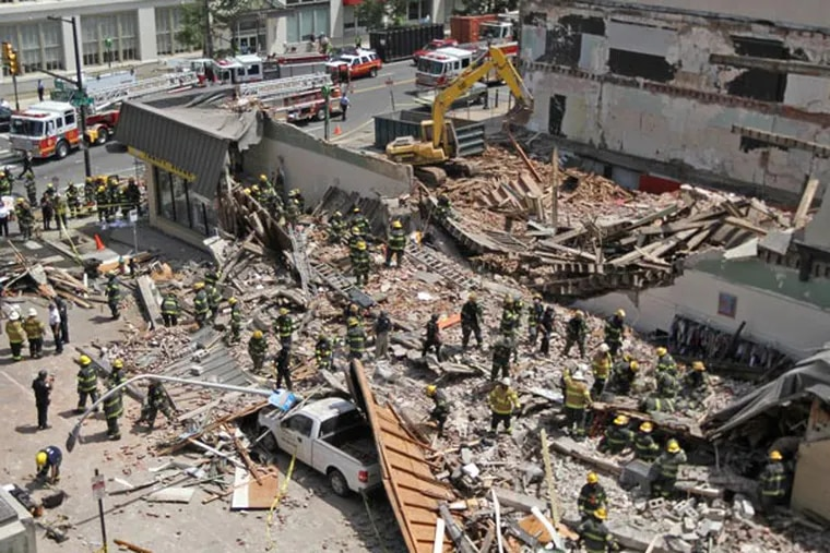 An overhead shot of the scene of the building collapse at 22nd and Market Street. An apartment building that was being torn down collapsed onto a one-story Salvation Army thrift store. Here, fire and police go through the rubble looking for survivors. ( MICHAEL BRYANT / Staff Photographer )