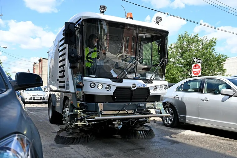 The Streets Department demonstrates  its new four-foot wide mechanical broom in North Philadelphia on Monday.