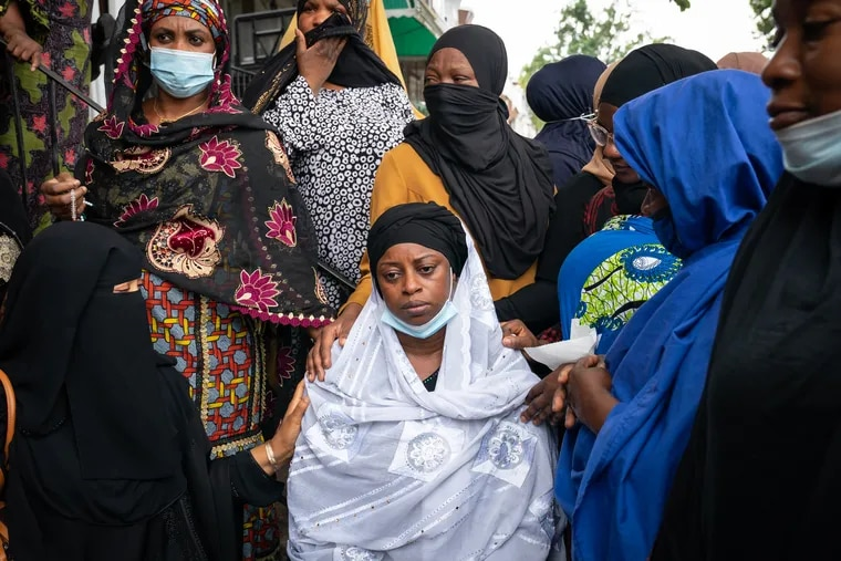Tennah Kromah, the mother of 8-year-old Fanta Bility, shown here surrounded by family members at the Masjid Ahlus-Sunnah Wal-Jammaah, in Southwest Philadelphia, August 31, 2021.