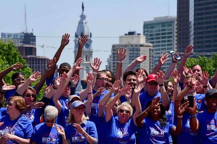Supporters sway to recorded music before the former vice president and Democratic presidential candidate Joe Biden arrives during a rally on Eakins Oval May 18, 2019.
