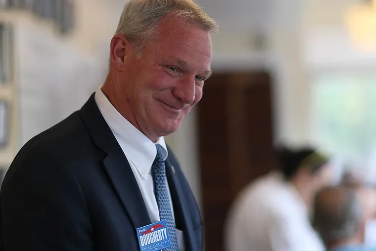 Kevin Dougherty visits Famous 4th St. Deli. He is among the Democratic winners for the three seats on the state Supreme Court. His campaign benefited from an influx of cash in the last two weeks. (DAVID MAIALETTI / Staff Photographer)