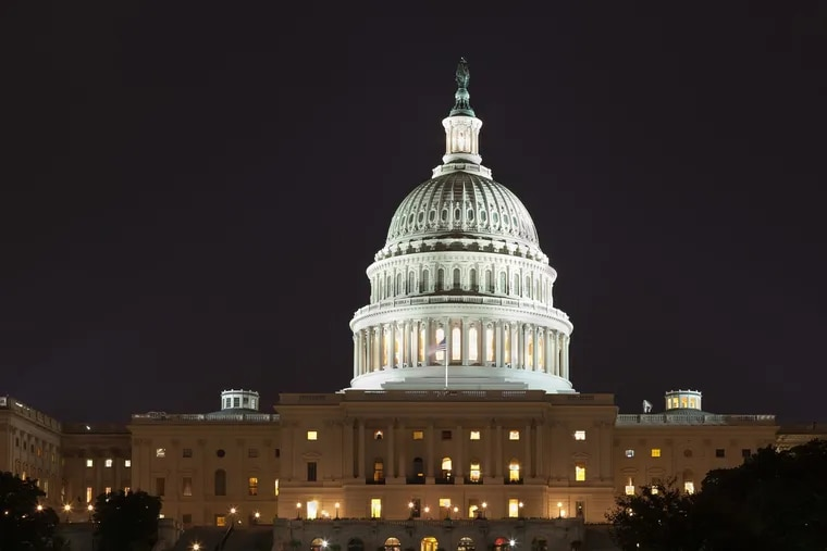 The U.S. Capitol building in Washington, D.C. Sen. Chris Coons (D., Del.) and Rep. Brian Fitzpatrick (R., Pa.) have introduced legislation to combat climate change and invest in the country's infrastructure.