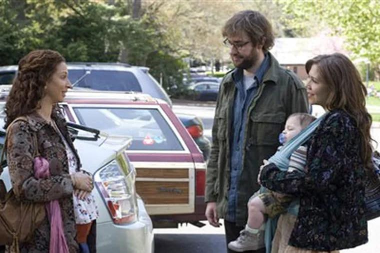 "Maya Rudolph, left, John Krasinski and Maggie Gyllenhaal star in ""Away We Go."" (AP Photo/Focus Features, Francois Duhamel)"