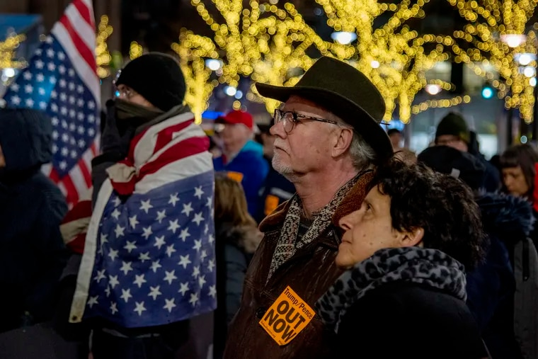 """Pat and Sam Hughes of Narberth join other protesters gathered at City Hall's Dilworth Plaza Feb. 5, 2020, one of a number of nationwide """"Reject the Cover Up: Demand Trump/Pence #OutNow"""" rallies protesting President Trump's impeachment acquittal."""