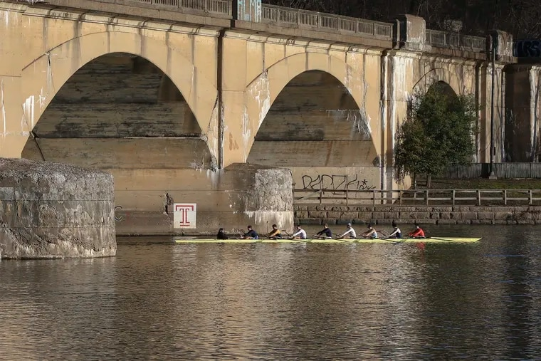 Crews rowing on the Schuylkill earlier this month; it's been that kind of winter. It should resume after a brief cold break this weekend.