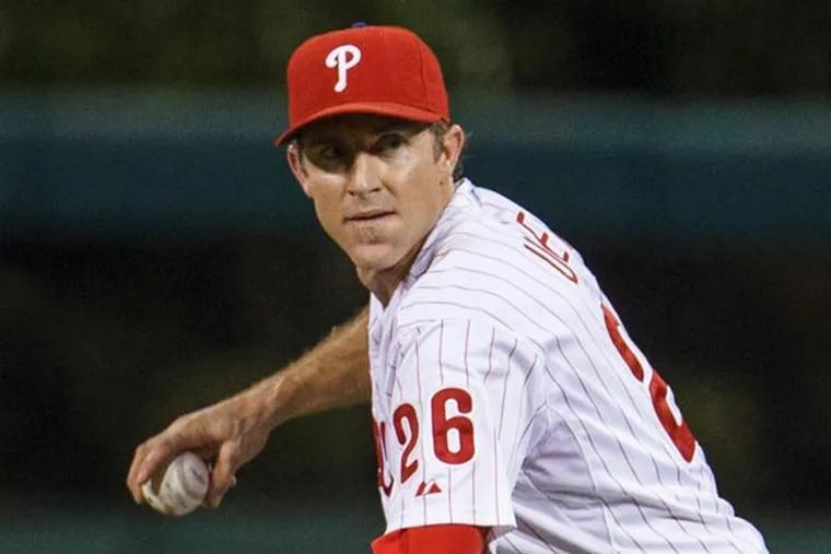 Chase Utley fields the ball during the eighth inning of a baseball game, Wednesday, Aug. 7, 2013, in Philadelphia. Chicago won 5-2. (Christopher Szagola/AP)