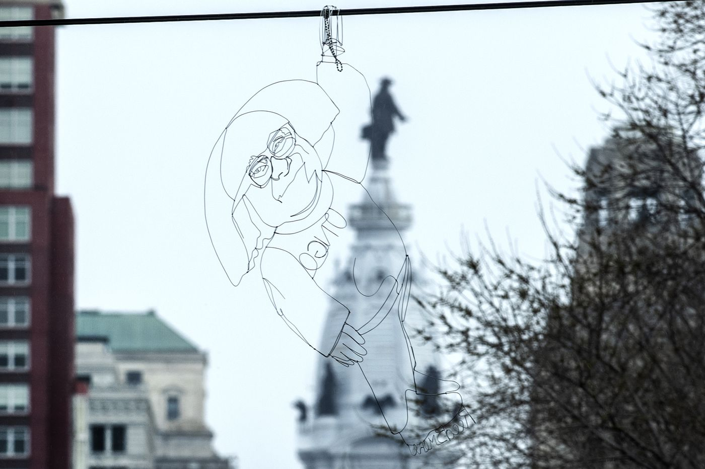 Dangling Danny DeVito sculpture from 'It's Always Sunny' is the latest Philly high-wire act by a Baltimore street artist
