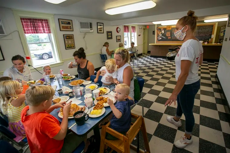 Diners inside a diner in Doylestown, Pa. Indoor dining has been permitted in all of Pennsylvania, except Philadelphia, since June. It starts in Philadelphia Tuesday, and begins in New Jersey on Friday.