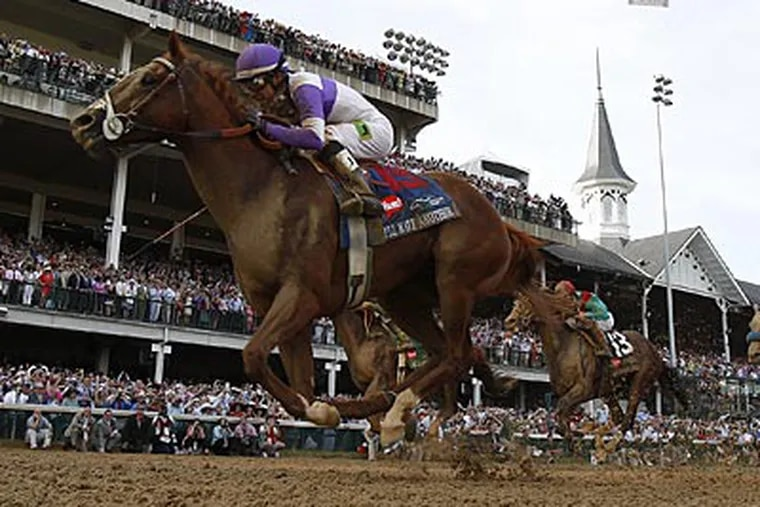Jockey Mario Gutierrez rides I'll Have Another to victory in the 138th Kentucky Derby. (David Maialetti/Staff Photographer)