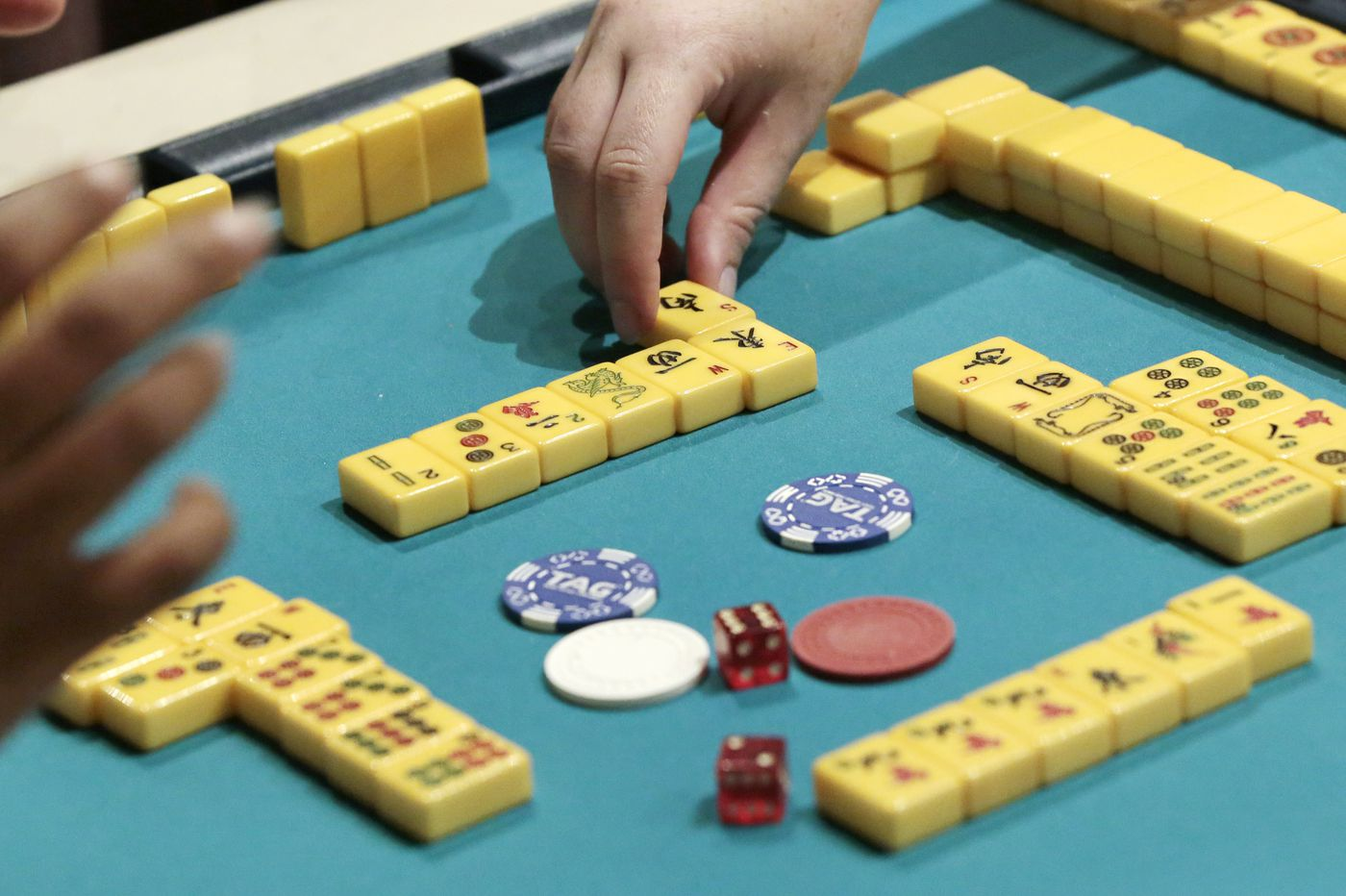 Philly's mahjong club brings a time-honored game to bottle shops, board-game cafes