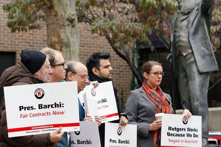 Rutgers-Camden faculty during a rally Oct. 23, 2014. Professors complained about salary freezes, the level of health insurance contributions, and what they described as a lack of support. (MICHAEL S. WIRTZ / Staff Photographer)