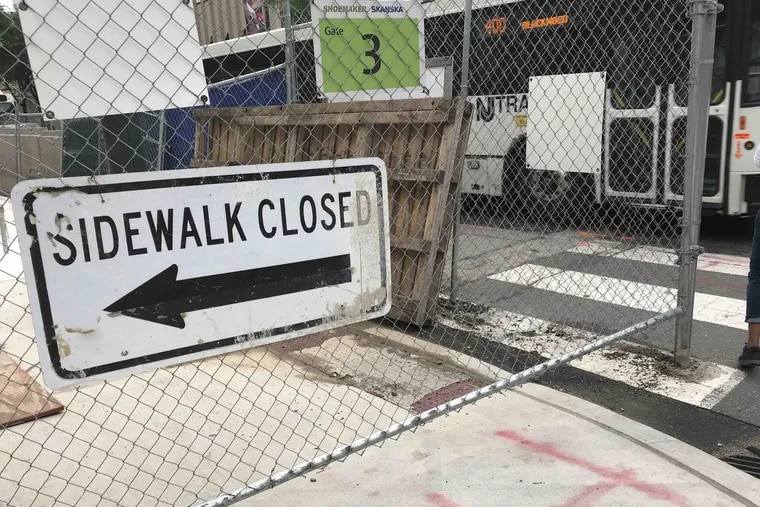 Closing streets or sidewalks for construction requires a city permit.