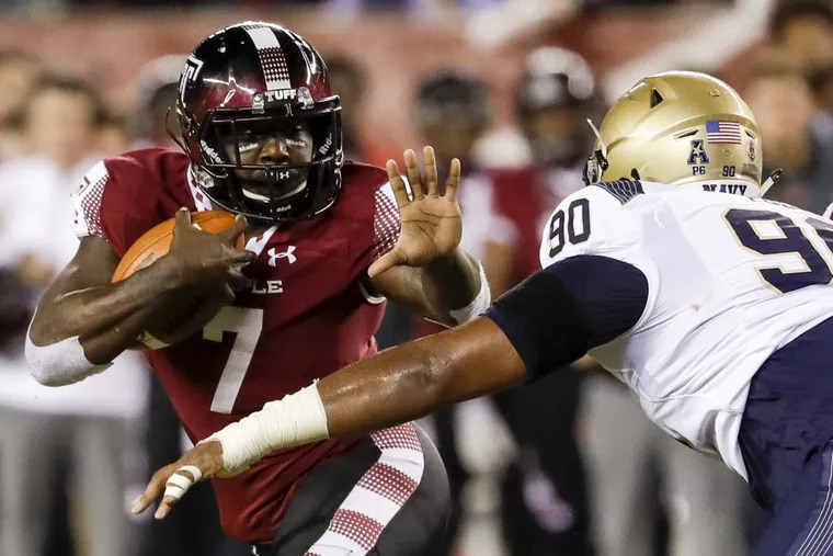 Temple running back Ryquell Armstead carries as Navy defensive end Jarvis Polu closes in during the second quarter of an NCAA college football game Thursday, Nov. 2, 2017, in Philadelphia. (Yong Kim/The Philadelphia Inquirer via AP)