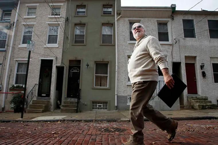 A Philadelphia assessor walks along Smick Street in Manayunk.