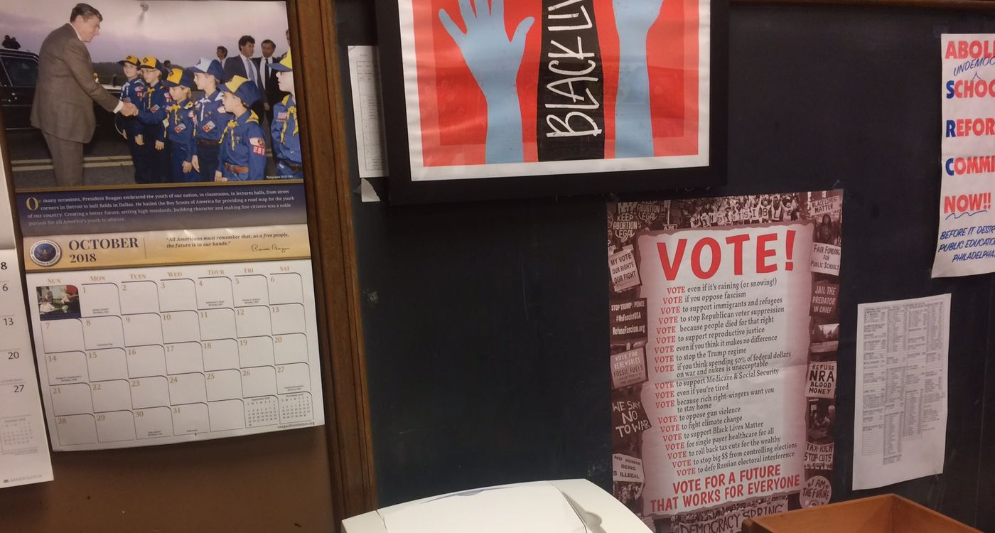 In this staff room at Central High School, teachers have posted political posters and signs from both sides of the aisle.