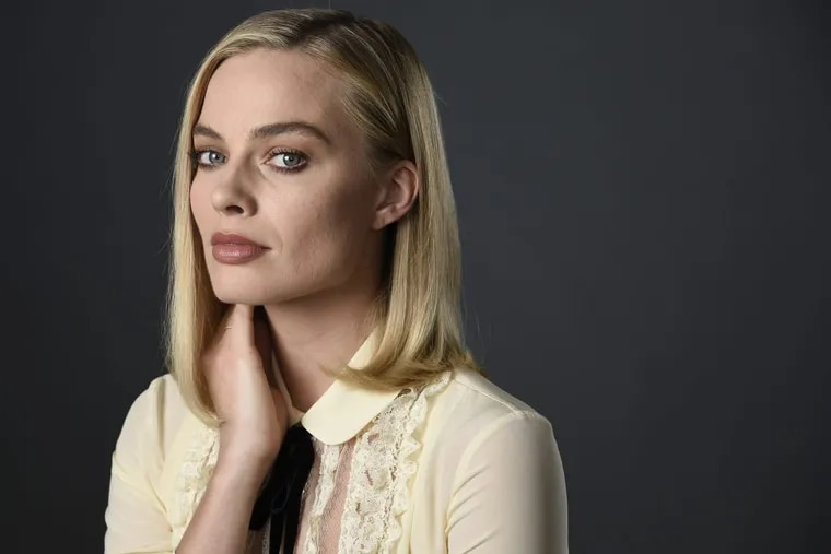 """In this Dec. 5, 2017 photo, actress Margot Robbie, a cast member in the film """"I, Tonya,"""" poses for a portrait at The Hollywood Roosevelt Hotel in Los Angeles. The film tells the story of the disgraced figure skater Tonya Harding from youth to middle age, including the infamous assault on fellow skater Nancy Kerrigan."""