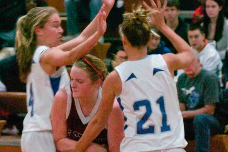 Sterling's Erica Hoffman (left) and Dylann Drechsler double-team Eastern's Amy Smolinski in the second period.