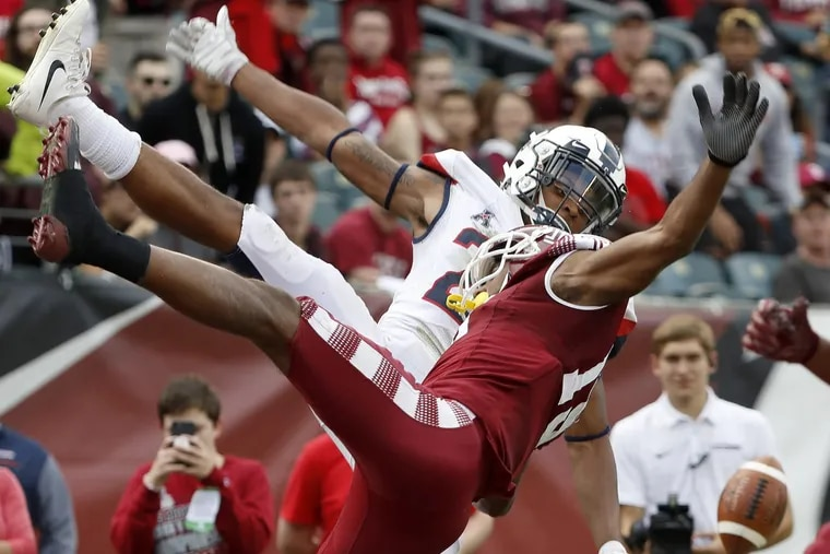 Temple's Ventell Bryant, right, fails to catch at fourth-down pass as UConn's Tyler Coyle, left, breaks up the pass near the end of the game.