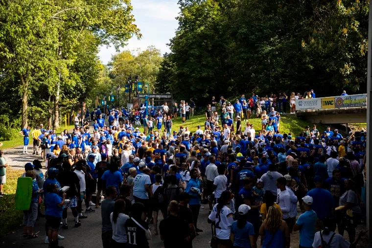 Families and friends cheer as Widener's players walk out from the locker room after winning their first home game against Hampden-Sydney Tiger's at Leslie Quick Stadium in Chester, Pa., on Saturday, Sept., 11, 2021.