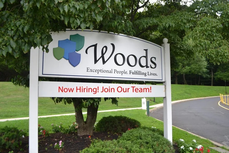 A sign at one of Woods Services' entrances at its campus near Langhorne.