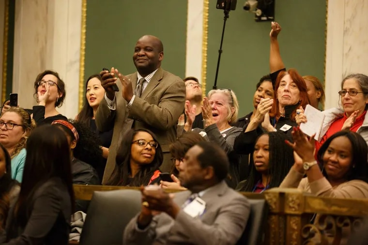 crowds in City Council react after Mayor  Kenney announces that the 16-year SRC experiment is ending.