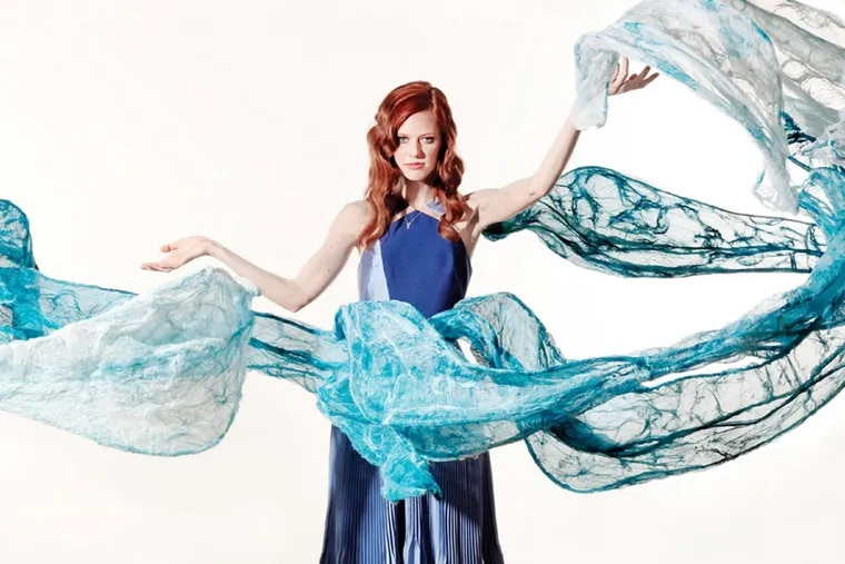 Pleated gown, Bibhu Mohapatra, $3,500, at Atelier Rittenhouse; arrow necklace, $579; arrow earrings, $775, both Safian & Rudolph, at Safian & Rudolph     Art: The Ocean's Whisper to Me, Linda Celestian  03/10/2015 ( Michael Bryant / Staff Photographer )