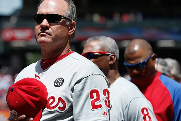 Ryne Sandberg (23) stands for the national anthem prior to a baseball game against the Arizona Diamondbacks on Sunday, April 27, 2014, in Phoenix. The Phillies defeated the Diamondbacks 2-0. (Ross D. Franklin/AP)